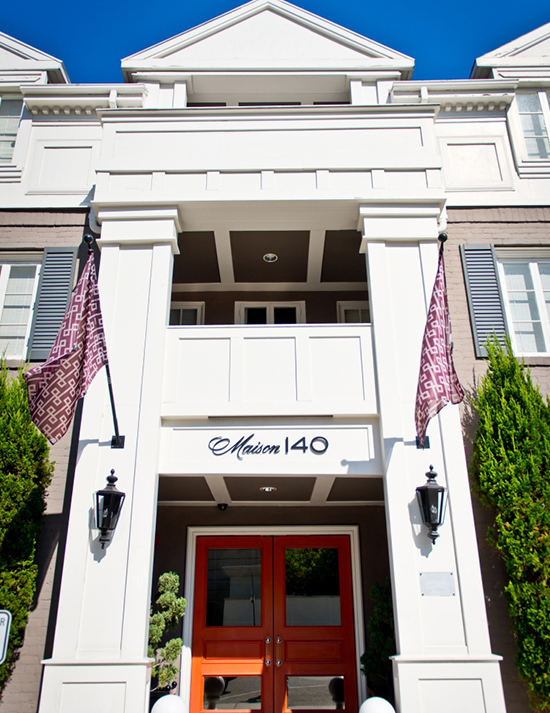 The front exterior of the boutique Maison hotel located in Los Angeles